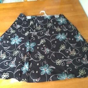 Covington black flare above the knee skirt